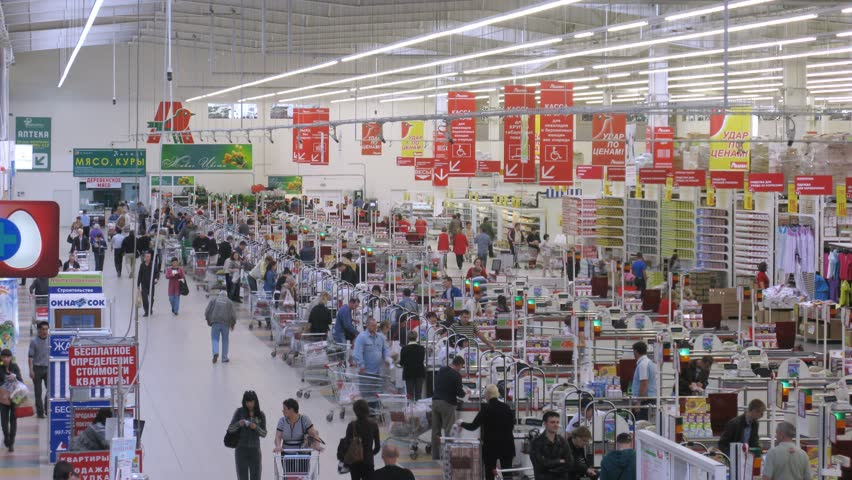 SAMARA - MAY 5: (Timelapse View) Customers buy products at checkout in Auchan, on May 5, 2012 in Samara, Russia. There are 50 Auchan superstores in Russia, with 12 added in the last 2 years alone.