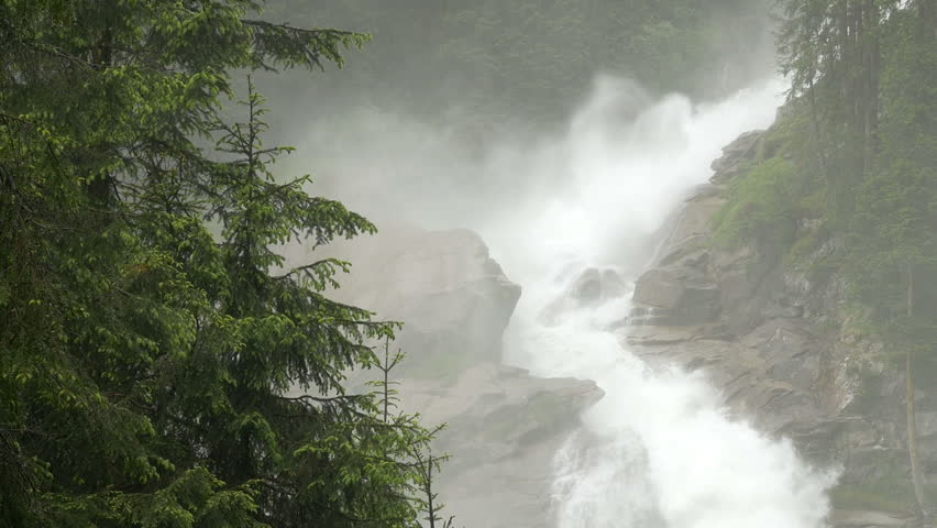 Zoom out on a portion of the Krimml Waterfalls in Salzburgland, Austria; includes ambient audio.