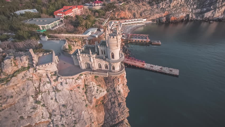 Aerial shot of the Swallow's nest, scenic castle and iconic landmark over the Black Sea in Yalta, Crimea
