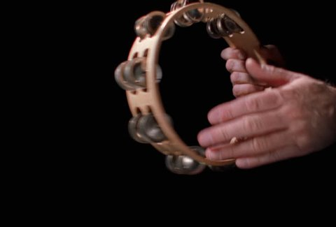 Close-up of tambourine being played