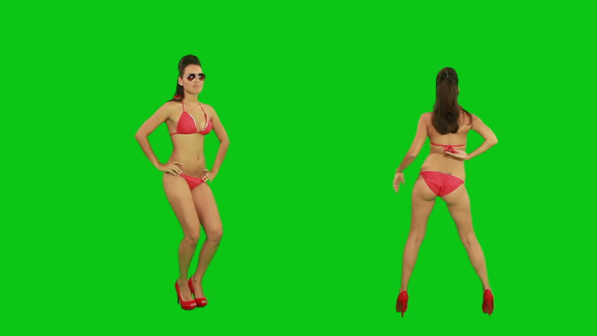 Beautiful young girl dancing against green screen