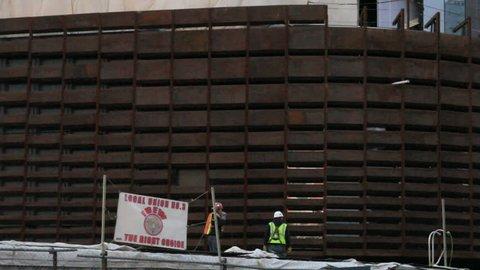 BROOKLYN, NY - FEBRUARY 15, 2012: Workers construct the Barclays Center in Brooklyn, NY