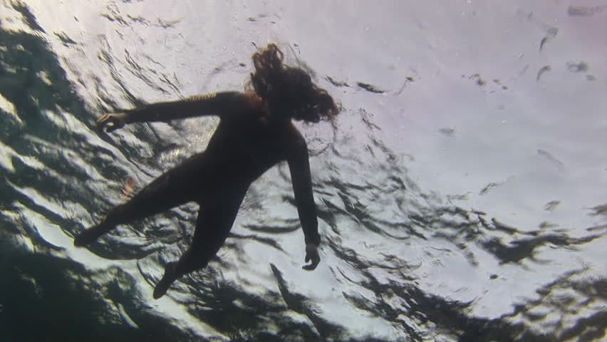 Silhouette of a girl in the water in Red Sea. Drowned. in Red Sea. Filming a movie.