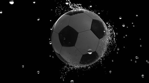 soccer ball moving through raindrops in slow motion isolated on black background with alpha