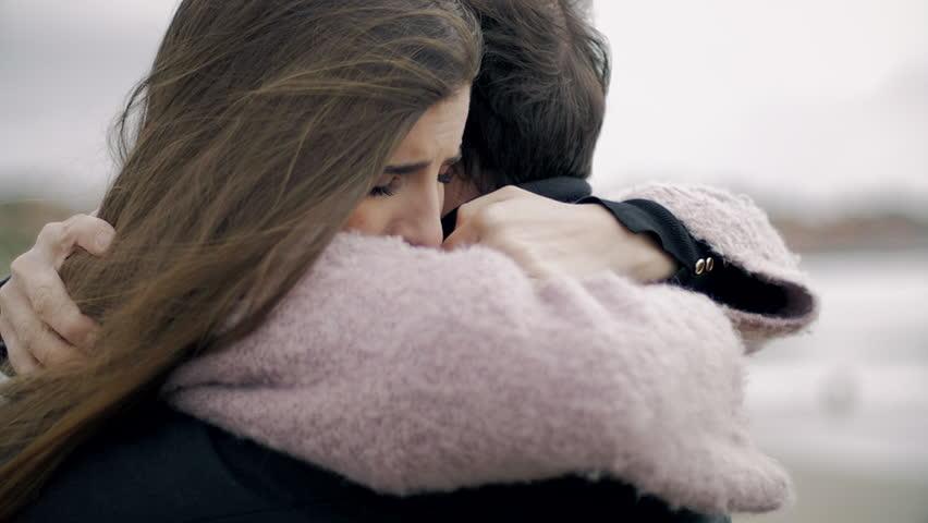 Woman hugging boyfriend feeling sad in love | Shutterstock HD Video #24908894