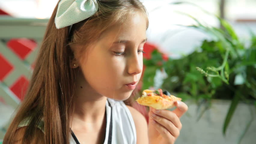 Little Girl Eating Pizza In Stock Footage Video 100 -1542