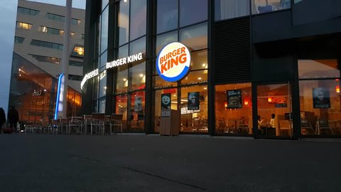Lyon, France - February 16, 2017: People Dining At The Burger King Restaurant in Lyon, France. Burger King is A Global Chain Of Hamburger Fast Food Restaurants Headquartered In Florida, United States