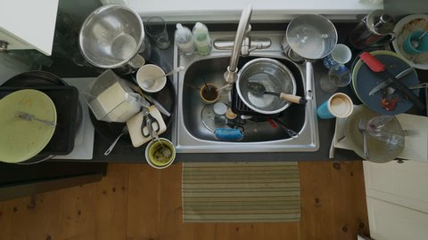 A rapid timelapse of a man washing dishes