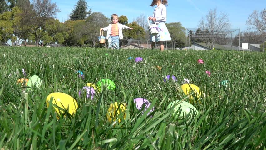 Slow motion of kids having fun gathering eggs at Easter hunt #24973229