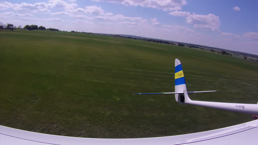 Flying over the Countryside, Bird's-eye, look back. Extreme camera is mounted on the wing RC glider