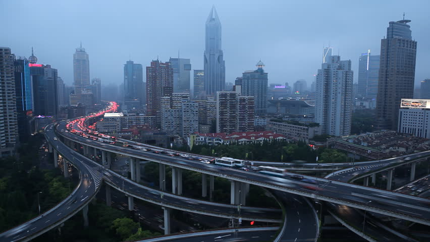 SHANGHAI, CHINA – MAY 9 2012: Time Lapse of Aerial View of Shanghai busiest highway, Yan'an East Road Overpass, Interchange at dusk #2498579