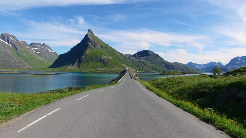 Driving a Car on a Road in Norway Lofoten #24991019