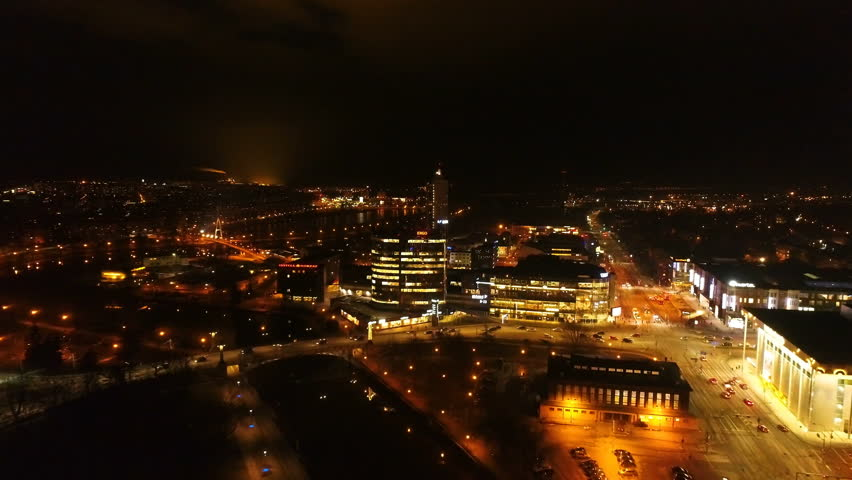 Nightscape city view of Tartu in Estonia buildings and houses with lights on and streetlighted roads where cars running and passing by | Shutterstock HD Video #25004669