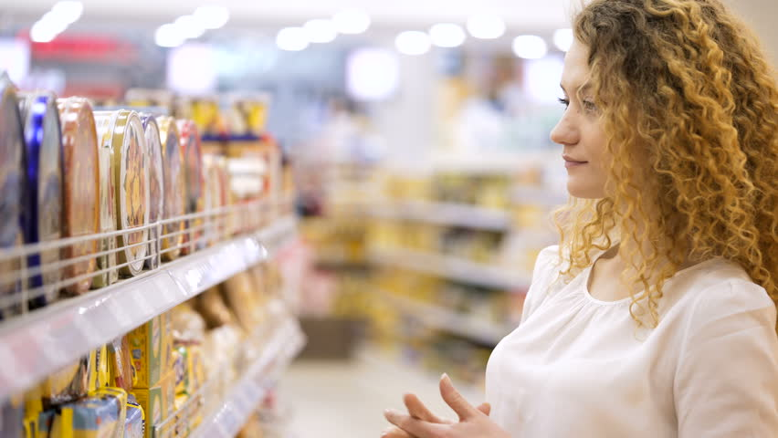 Attractive young woman buying products. Looking and choosing. Shopping in Grocery Store or Supermarket. purchaser Shopping in Grocery Store or Supermarket | Shutterstock HD Video #25025129