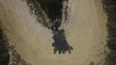 Overhead aerial of Subaru Rally Car drifting around a hairpin corner fast