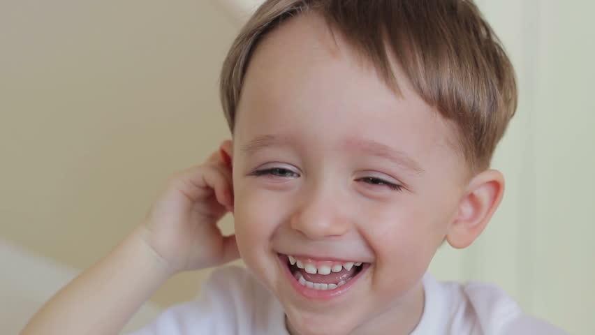 Kid Making Smiling Faces
