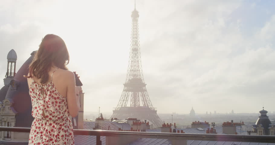 Tourist couple taking photograph of Eiffel Tower using smartphone hotel balcony at sunrise photographing scenic Paris cityscape background view enjoying European honeymoon vacation travel adventure | Shutterstock HD Video #25124450