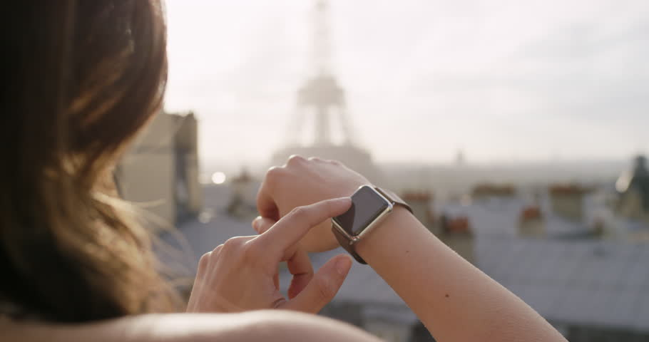 Tourist Woman touching smartwatch in city texting sharing lifestyle photo enjoying holiday European vacation travel adventure | Shutterstock HD Video #25124516