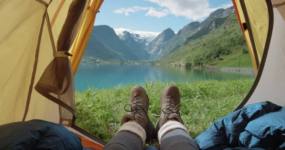 Camping woman lying in tent Close up of Girl feet wearing hiking boots relaxing on vacation POV | Shutterstock HD Video #25126919