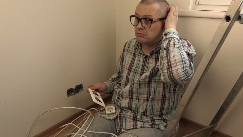 Man trying to fix electrical sockets    | Shutterstock HD Video #25132199