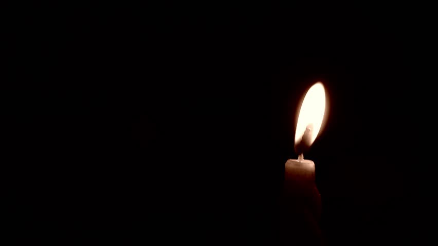 Flickering candle flame burning against a dark background - sepia toned   Shutterstock HD Video #25136309
