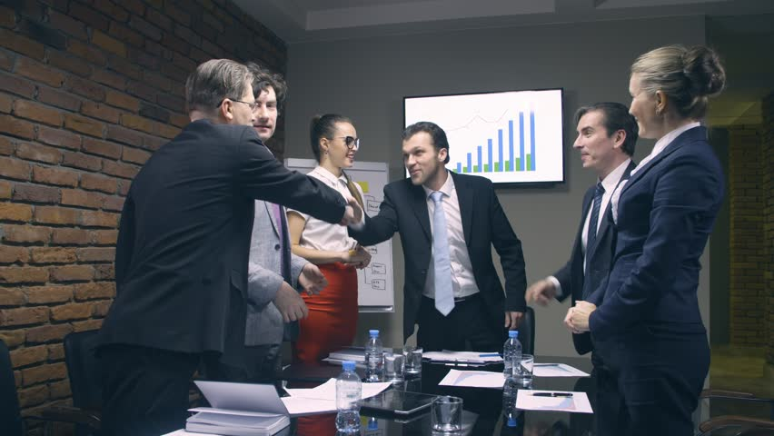 Business people shake hands at the end of meeting