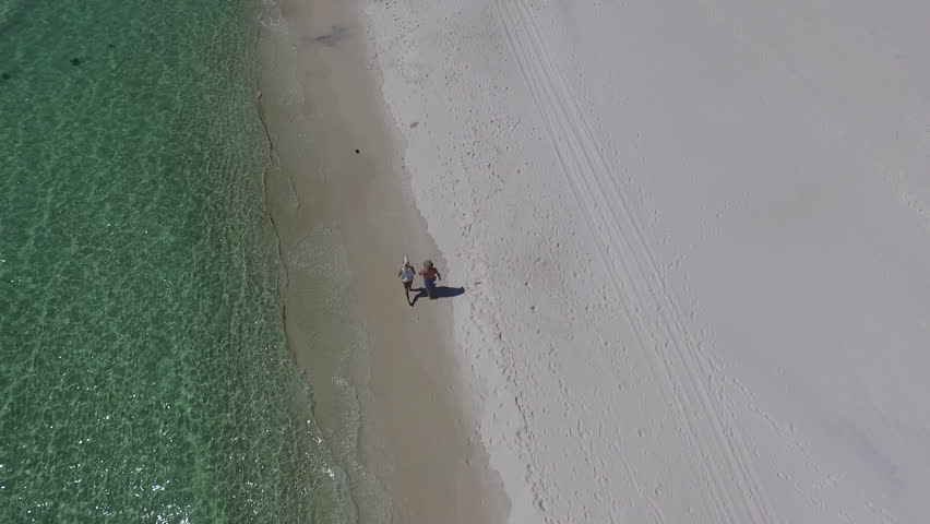 Top-down people walking the beach. drone