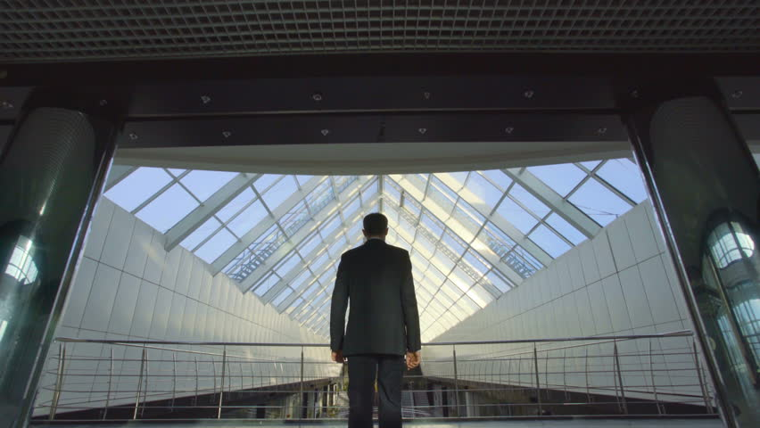 The businessman walk in the business center bridge