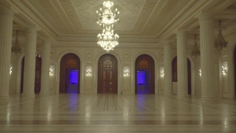 Interior of pompous palace with golden chandelier // magnificent castle interior rooms