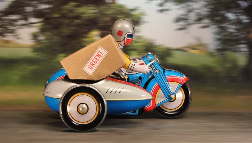 Tin toy Delivery motorbike and sidecar speeding along a rural road with an urgent parcel.