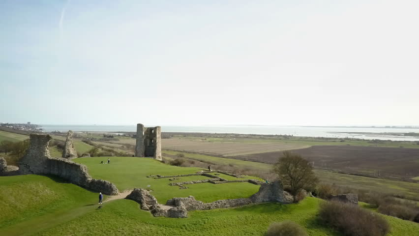Hadleigh Castle, Essex, England. Drone video footage flying forward over the ruins of an ancient 13th Century castle near Hadleigh in Essex revealing the English countryside and River Thames estuary.