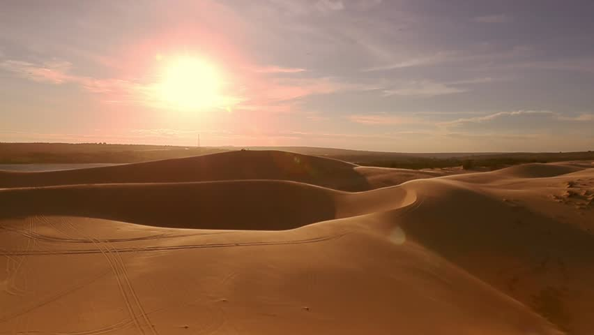Desert horizon Panning right. Sunset. Horizon line sand dunes and blue sky. Beautiful landscape. Sahara desert horizon. Sand dunes and sky Arabian desert. Sand dunes wave pattern. Nature background | Shutterstock HD Video #25349429