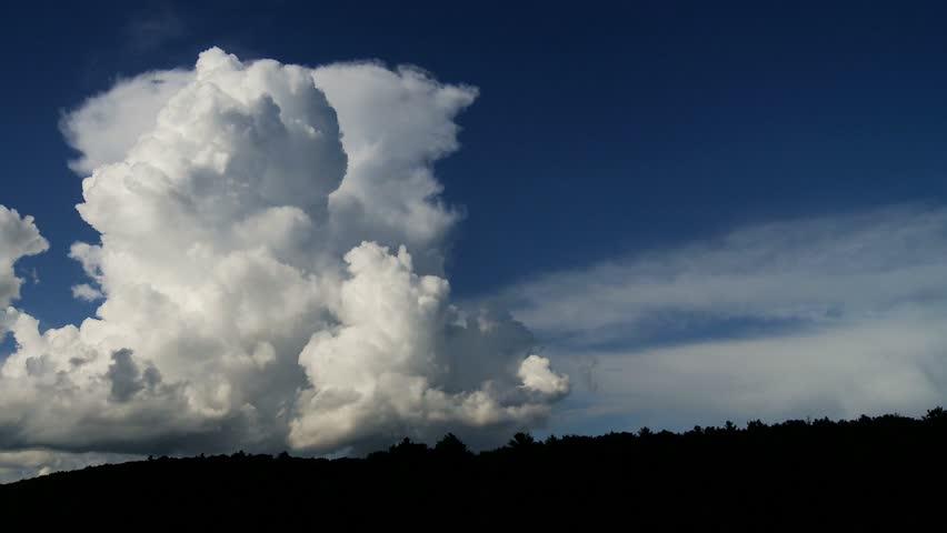 Cumulus clouds time-lapse against bright blue sky
