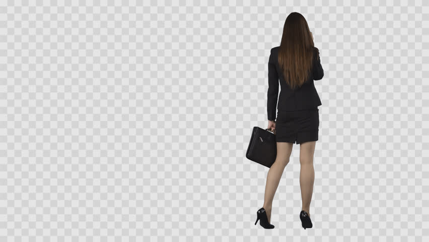 Attractive business woman in short skirt is strolling and talking by phone. Back view. Isolated on transparent background