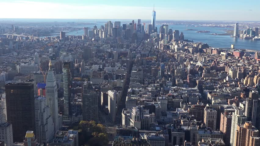 Panoramic and aerial view of Manhattan buildings in New York City, NY, USA. New york city skyline aerial view at sunset. Urban metropolis landmark scenery background.  | Shutterstock HD Video #25434599
