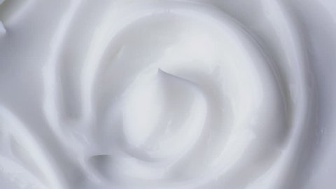 White gentle cosmetic cream. Cosmetics cream with rotate. Close-up shot.