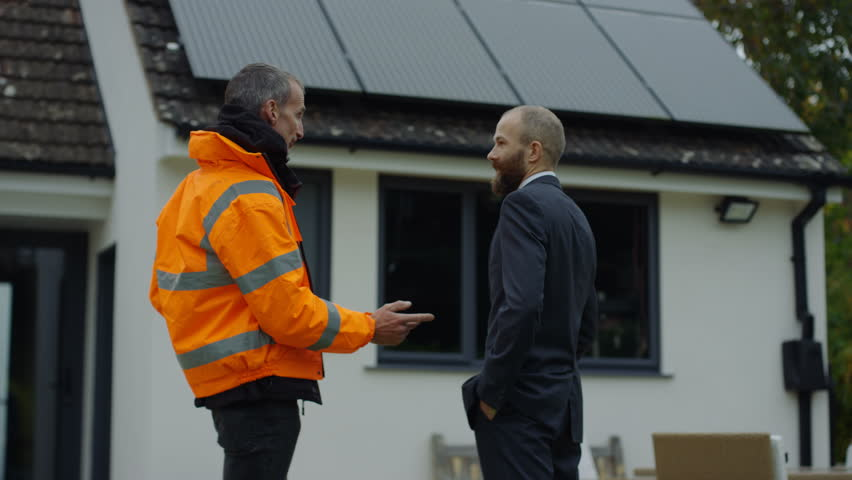4K Engineer & homeowner discuss solar panels on roof & shake hands on a deal