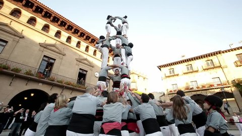Barcelona, Spain - June 1, 2016 : Group of people makes human tower in Barcelona, Spain on June 1, 2016. Worldwide famous catalan human towers are on UNESCO's Cultural Heritage List.