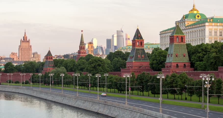 Morning view of the Moscow Kremlin embankment from river with International Business Center Moscow City and Ministry of Foreign Affairs of Russia behind. 4K time lapse from night to day with zoom in