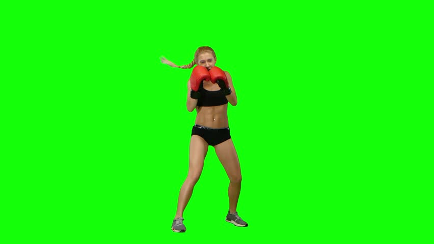 Boxer standing in the front and sends butted an opponent standing on the spot. Green screen #25547219