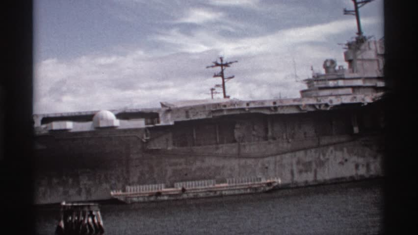 SEATLLE WASHINGTON 1974: an old wwii era battleship docked next to a submarine, seen at daytime | Shutterstock HD Video #25550129