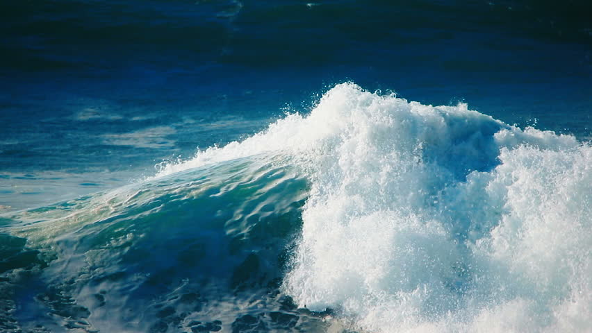 Slow motion of big ocean surfing wave - close up video of blue, turquoise rough sea water splashing, crashing, breaking, spraying tropical Hawaii north shore beach, nature power, landscape background