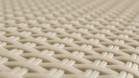Beige rattan decorative furniture material close-up 4K 2160p 30fps UltraHD tilting footage - Plastic wicker artificial container texture slow tilt 3840X2160 UHD video