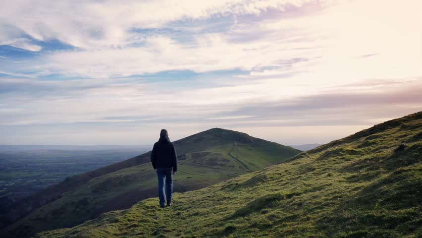 Man Walks Over Hilltop At Sunset | Shutterstock HD Video #25603019