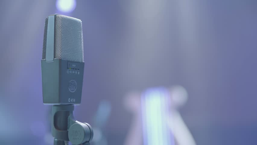 KIEV,UKRAINE - JUNE 3, 2016. Professional microphone for recording audio on stage, in the light. Close-up | Shutterstock HD Video #25615229