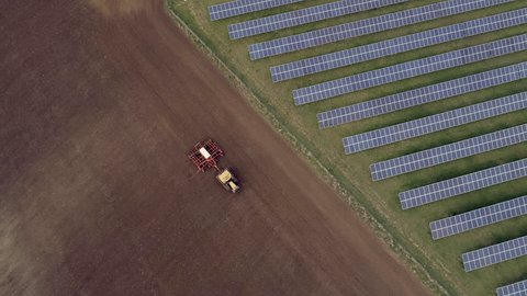 Traditional Farming Next To New Age Solar Farming