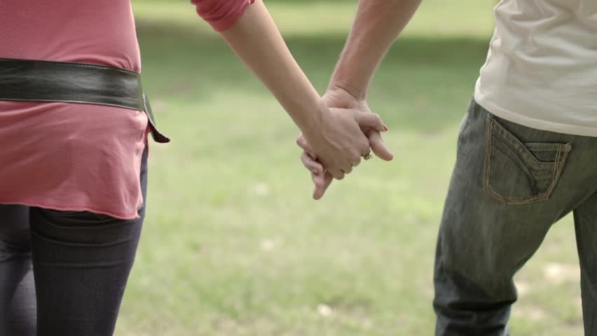Man And Woman Holding Hands. Stock Photo - Image of loving