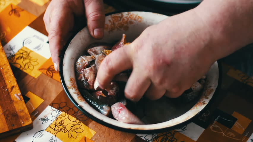 A man cook stirs fresh fish in a bowl with spices | Shutterstock HD Video #25671419
