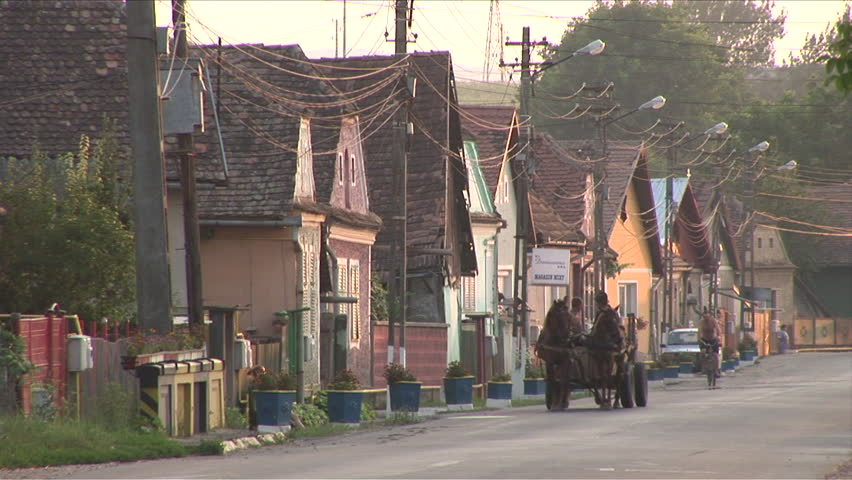 Romania - CIRCA July, 2006: A quiet street in a small town during dusk