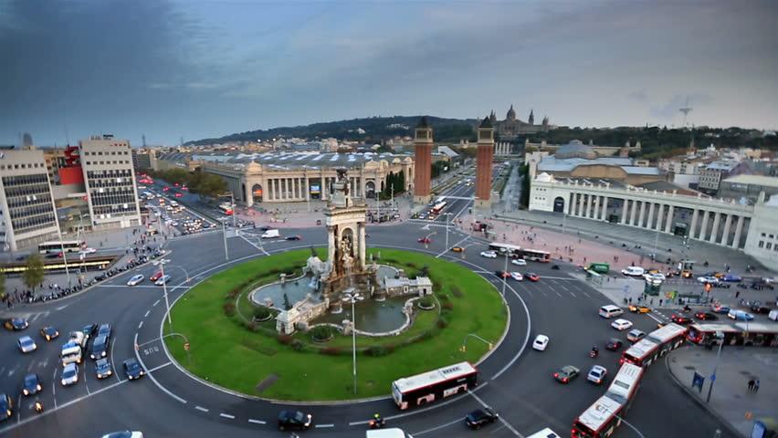 Timelapse city traffic with Venetian Towers Plaça d'Espanya, Plaza de Espana of Squares in Barcelona at Sunset
